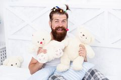 Slumber party. Guy relaxing in bedroom. Pajamas style. Man in pajamas at home. Having fun pajamas party. Childlike again. Man adult bearded handsome hipster royalty free stock photos