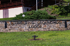 Slumbering Groundhog Lodge Sign Stock Photo