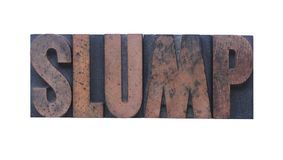 Slump. The word 'slump' in old ink-stained wood type Stock Photos