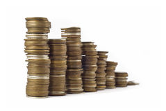 Slump or growth - towers assembled. Of coins shallow DOF with focus on the left side Stock Photos