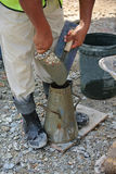 The slump test equipment. Wet concrete was compacted for the slump test. Stock Photography