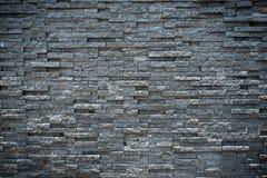 Slumpmässig svart granitstenvägg Royaltyfri Bild