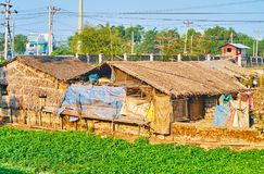 The slums in East Dagon Township, Yangon, Myanmar. The slums in countrye area of East Dagon Township, locals use lands at the railroads to grow vegetables and Stock Image