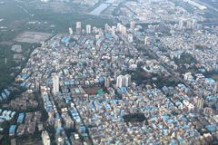 Mangroves, slums and highrises in Mumbai. Slums and highrises in a suburb of Mumbai near the mangroves royalty free stock image