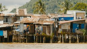 Slums in Nha Trang. Houses on the river. Slums in Nha Trang. Houses on the river Stock Photos