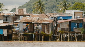 Slums in Nha Trang. Houses on the river. stock video