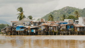 Slums in Nha Trang. Houses on the river. Vietnam. stock video footage