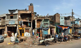 The Slums of Old Delhi Panorama, India. Delhi, India - April 08, 2012: Panoramic view of a section of slum houses and residents in Old Delhi Stock Images