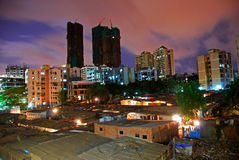Slums and the Tall Towers Stock Photography