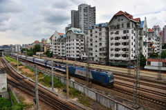 Slums and train. A train is passing through the slums in Shenzhen, China Royalty Free Stock Photography