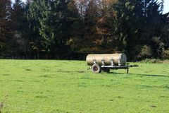 Slurry tank in the field. Slurry tank left behind in the field, normally used for fertilize the land stock image