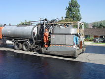 Slurry Truck. Truck preparing to slurry middle of road Royalty Free Stock Photos