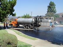 Slurry Truck Laying Hot Slurry. Truck laying hot slurry on residential street in Glendora, California Royalty Free Stock Photography