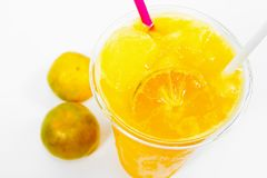Slush ice with orange in Plastic Cup on background.  royalty free stock photo