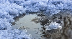slush with puddles and wet snow in the winter close up stock images