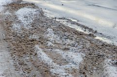 Slushy snow with mud. Slushy snow with mud on the road Stock Image