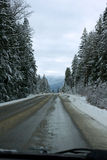 Slushy Winter Road. Early winter road covered in slush, can be used to depict weather/road conditions Stock Images