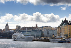 Slussen and the old town from the seaside with boats and clouds Stock Photos