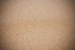 Slut för sandstrandtextur upp arkivfoto
