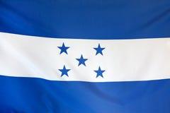 Slut för verkligt tyg för Honduras flagga sömlöst upp Royaltyfri Bild