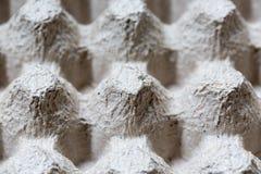 Slut som specificeras upp av pappers- bakgrund för textur för äggbehållareask Royaltyfri Bild