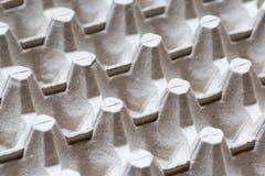 Slut som specificeras upp av pappers- bakgrund för textur för äggbehållareask Royaltyfria Foton