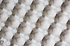 Slut som specificeras upp av pappers- bakgrund för textur för äggbehållareask Royaltyfri Fotografi