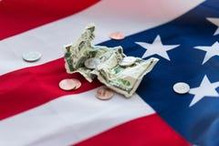 Slut upp av amerikanska flaggan och pengar Fotografering för Bildbyråer