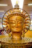 Slut upp av bronsskulptur av Lord Buddha Arkivfoton