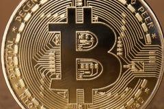 Slut upp av den guld- bitcoincryptocurrencyen arkivfoton