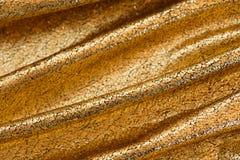 Slut upp av den guld- torkduken fotografering för bildbyråer