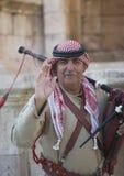 upp av den jordanska militära säckpipe- spelaren Royaltyfri Foto