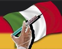 Slut upp av den kontanta injektionen på italiensk flagga mot tysk flagga Fotografering för Bildbyråer