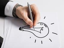 Slut upp av den manliga handen med pennteckningskulan Fotografering för Bildbyråer