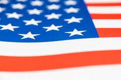 Slut upp av den pappersUSA flaggan, selektiv fokus på en stjärna Royaltyfri Fotografi