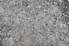 Slut upp av den våt grå grusvägen eller jordning Royaltyfri Fotografi