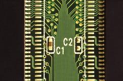 Slut upp av det kulöra mikroströmkretsbrädet abstrakt bakgrundsteknologi Datormekanism i detalj Royaltyfri Foto