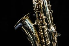 Slut upp av en guld- saxofon fotografering för bildbyråer