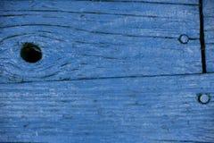 Slut upp av en målad blå wood vägg Royaltyfri Bild