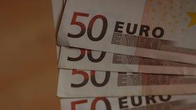 Slut upp av en sedel för euro 50 lager videofilmer