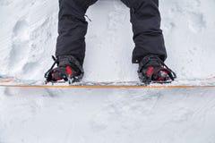 Slut upp av en snowboard Arkivbilder
