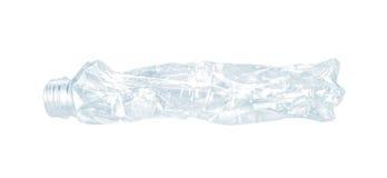 Slut upp av en tom använd plast- flaska på vit bakgrund Royaltyfri Bild