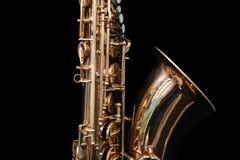 Slut upp av ett guld- saxofonanseende royaltyfri fotografi