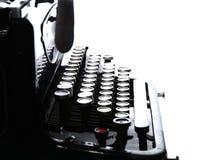 Slut upp av gamla den isolerade tappningskrivmaskinen Arkivbild