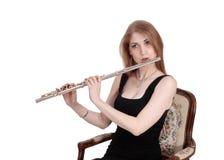 Slut upp av kvinnan som spelar flöjten Royaltyfria Bilder