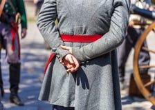 Slut upp av manuppklädden som en 19th århundradesoldat för årsdagen av striden av Alamoen royaltyfri foto