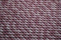 Slut upp av modeller för tak för blandningfärgtegelplatta royaltyfria bilder