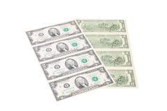 Slut upp av oklippta två dollarräkningar. Royaltyfri Bild