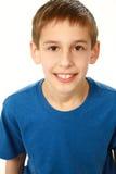 Slut upp av pojken i blå skjorta Royaltyfria Bilder
