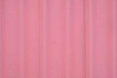 Slut upp av rosa yttersida för tegelplattatak Arkivbild